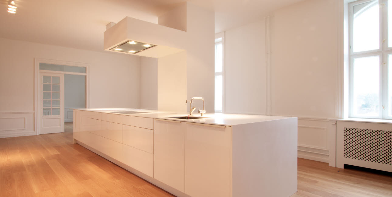 White designer kitchen in luxury apartment